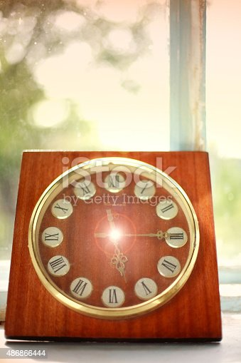 671883446 istock photo Vintage clock at the old rural window, concept of time 486866444