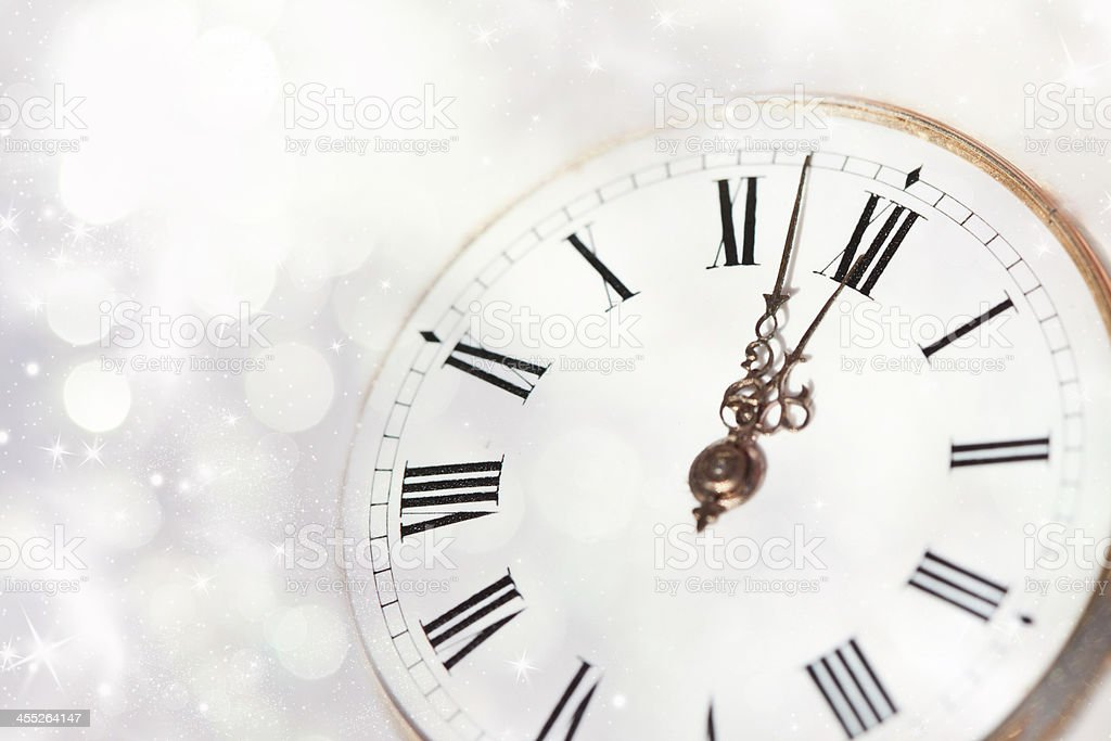 Vintage clock on a white star and snowflake background stock photo