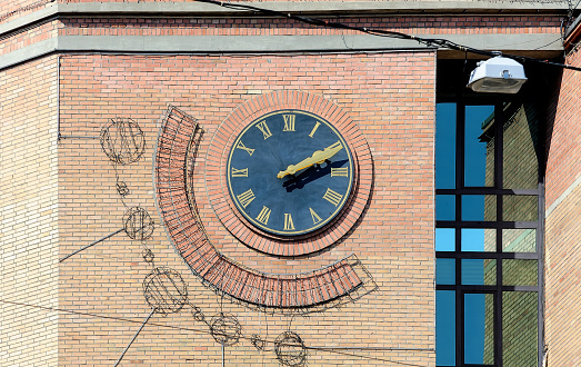 Vintage clock on the wall of old building in Kyiv Ukraine
