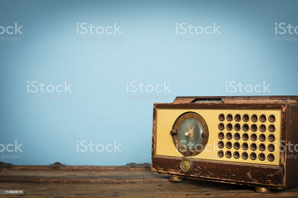 Vintage Clock Radio Sitting on Old Wood Trunk stock photo