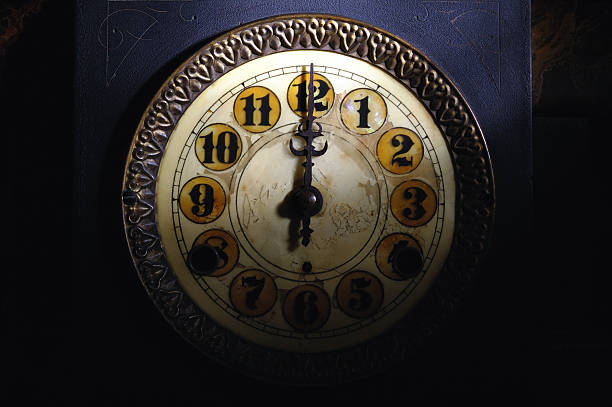 Vintage Clock Striking 12  midnight stock pictures, royalty-free photos & images