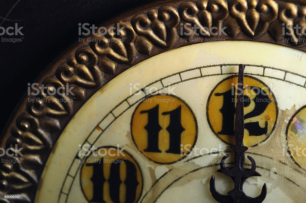 Vintage Clock Striking 12 royalty-free stock photo