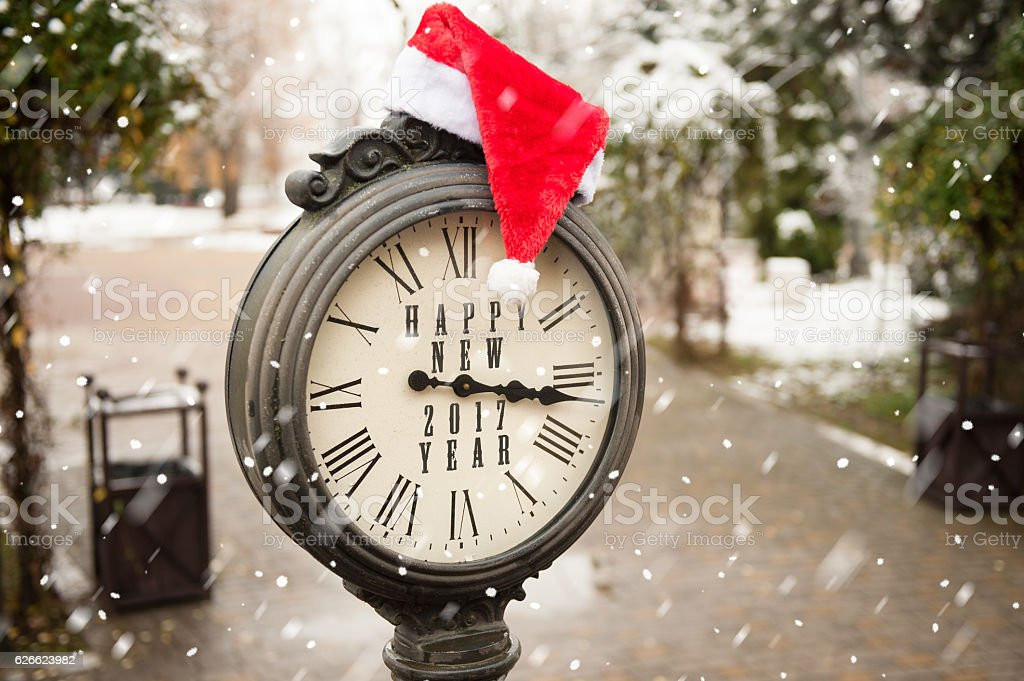 vintage clock with santa hat and words Happy New Year stock photo