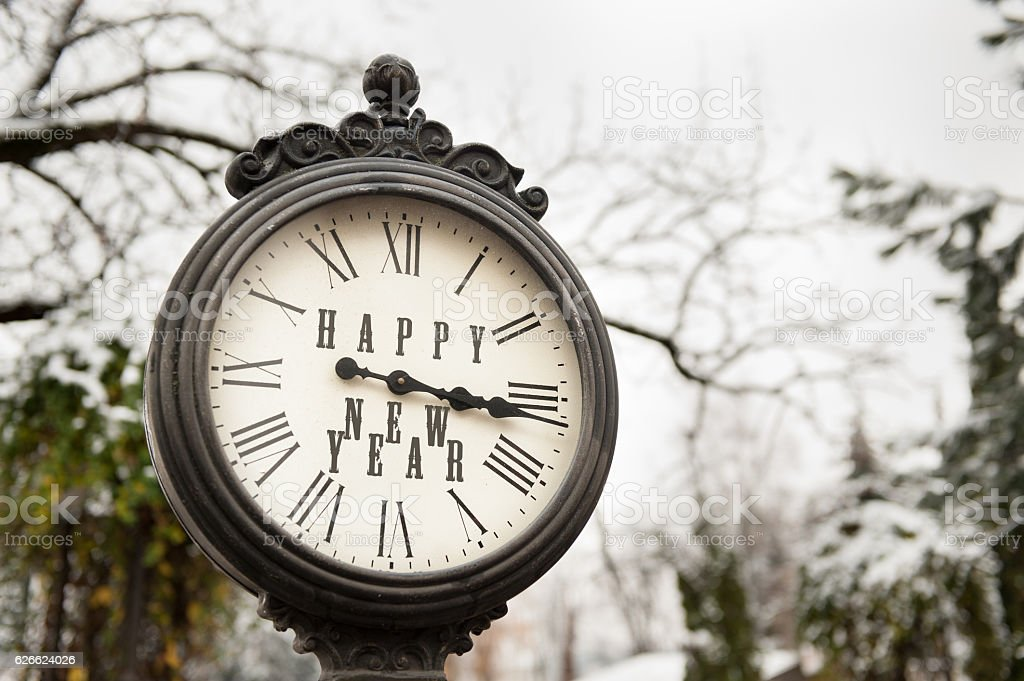 vintage clock with title Happy New Year stock photo