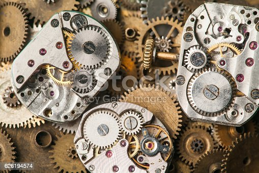 istock Vintage clocks mechanism close-up. Aged hand watches parts on 626194574