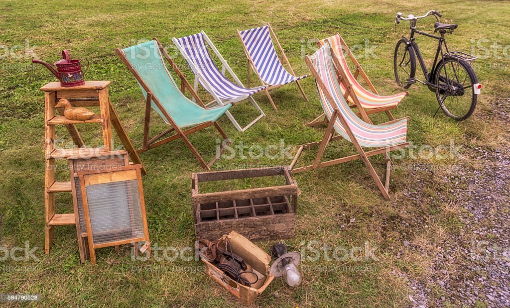 Vintage clothe Deckchairs with wooden ladder and washbords stock photo