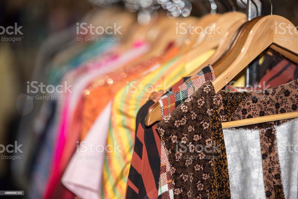 Vintage clothes for sale inside a shop stock photo