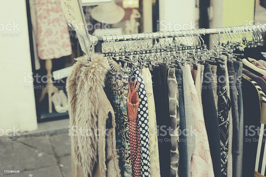 Vintage Clothes on a rack outside second hand store. stock photo