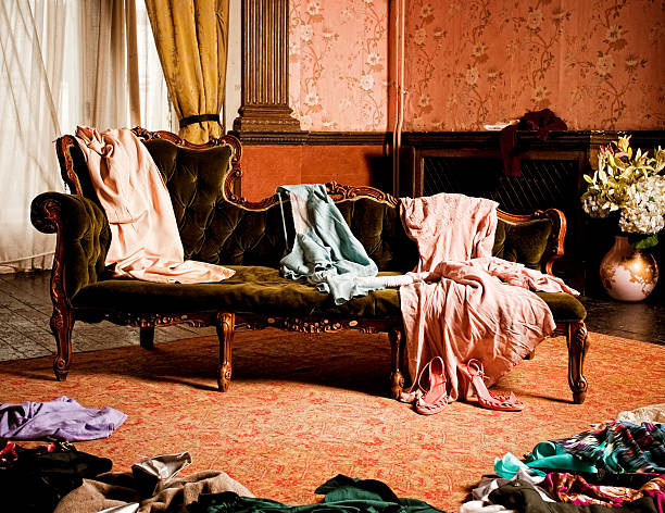 Vintage clothing scattered in a woman's dressing room stock photo