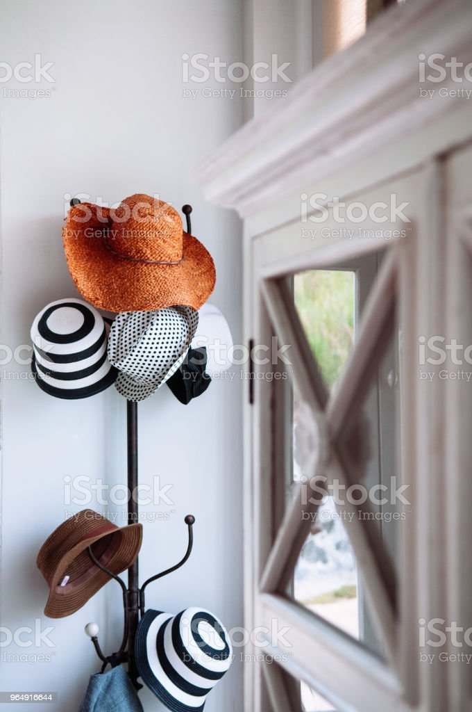 Vintage coat rack, Hat hanger with beautiful nice straw hats royalty-free stock photo