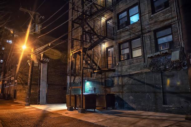 Vintage cobblestone brick city alley at night in Chicago stock photo
