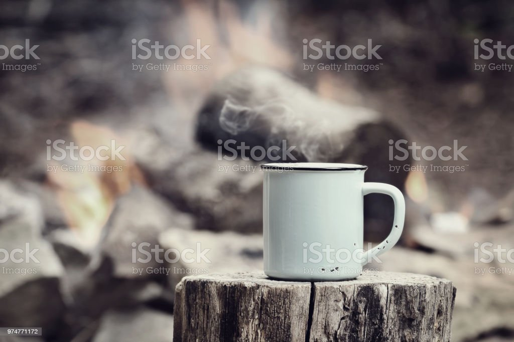 Vintage Coffee by a Campfire stock photo