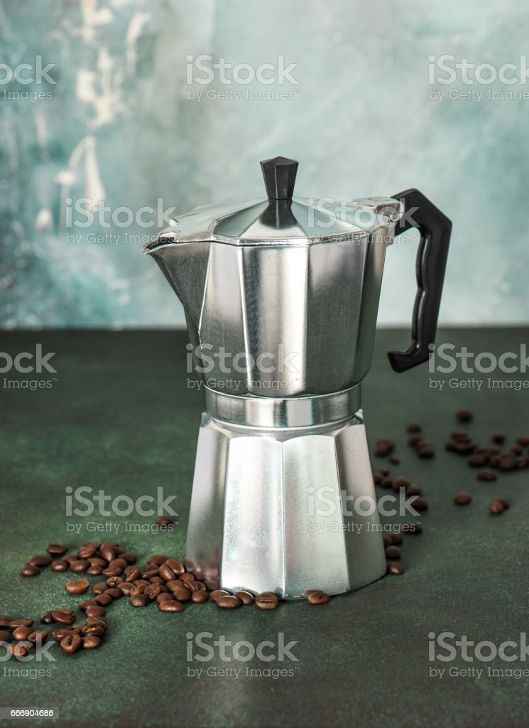 Vintage coffee maker beans stone background stock photo