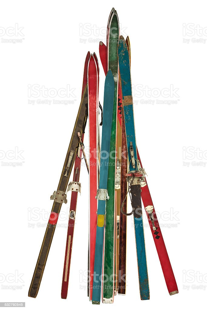 Vintage collection of used skis isolated on white stock photo