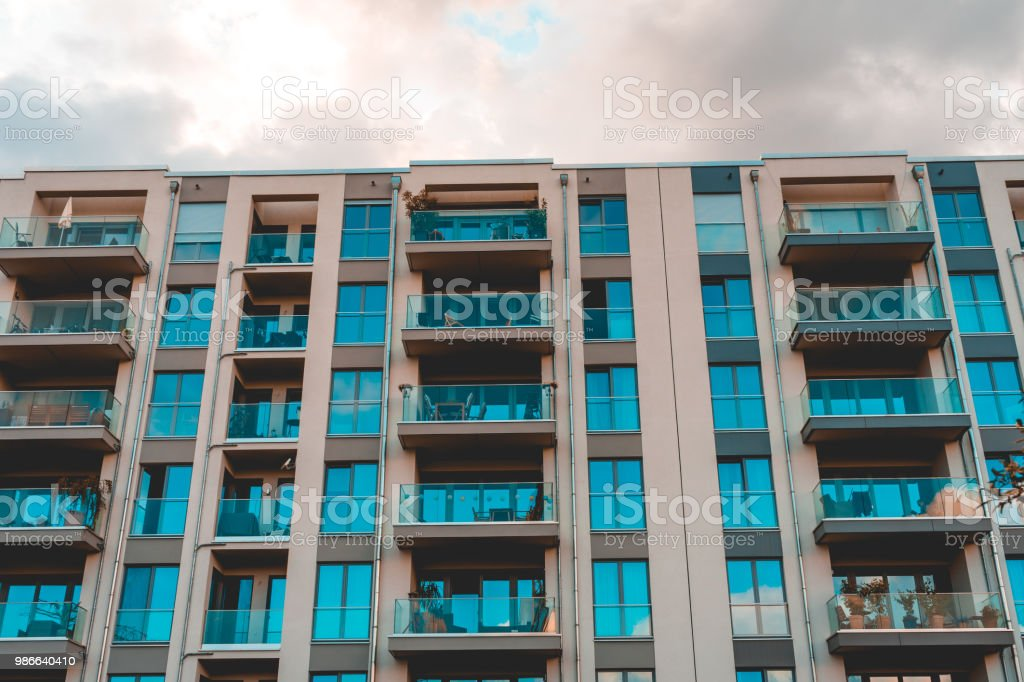 vintage colored picture of apartment building with glass balcony