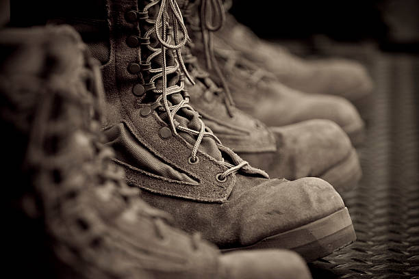 Vintage Combat Boots Combat boots processed in a sepia/vintage style. boot stock pictures, royalty-free photos & images