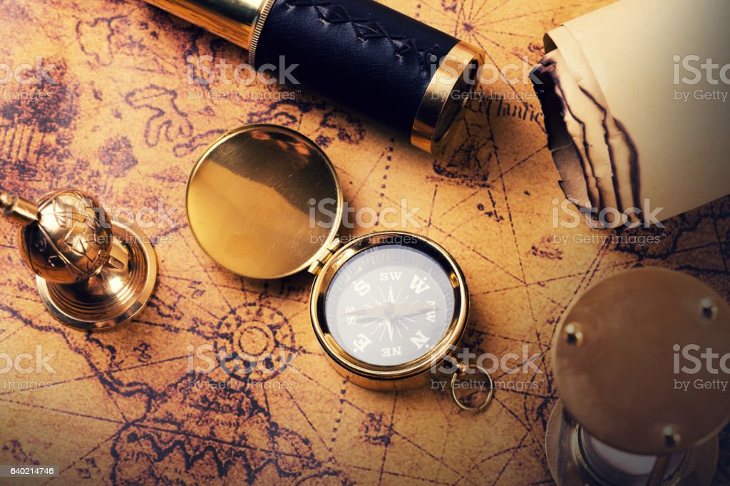 vintage compass and equipment on ancient treasure map stock photo