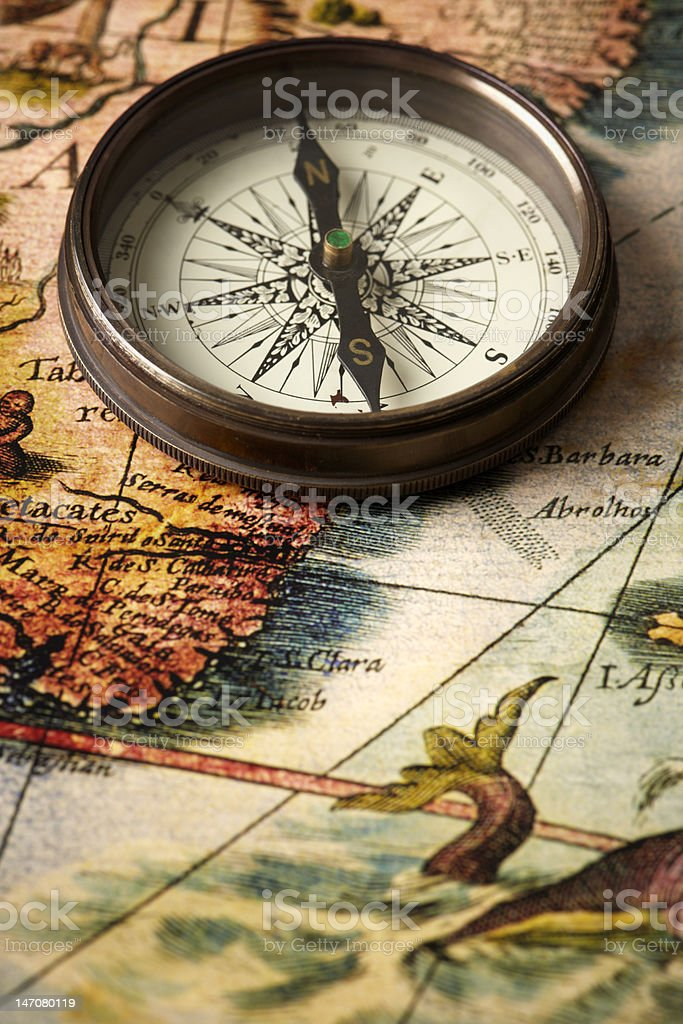 vintage compass on a map royalty-free stock photo