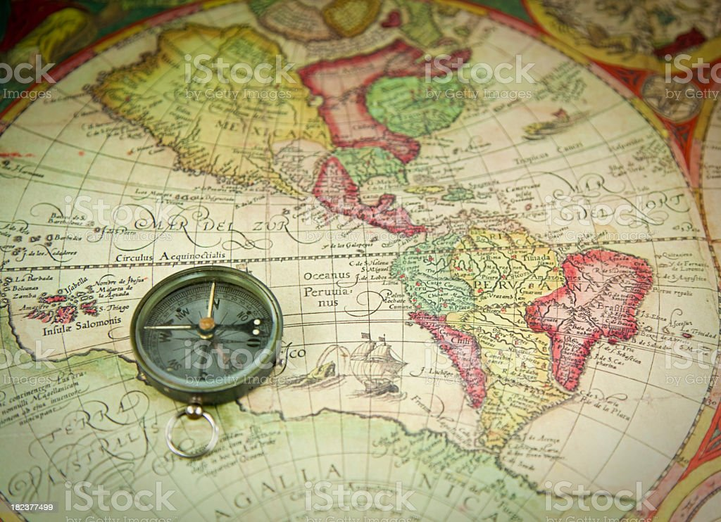 Vintage Compass on an Antique Map stock photo