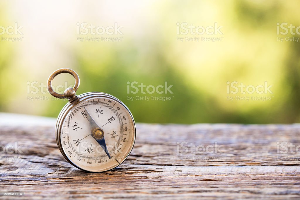 Vintage compass on wooden background stock photo