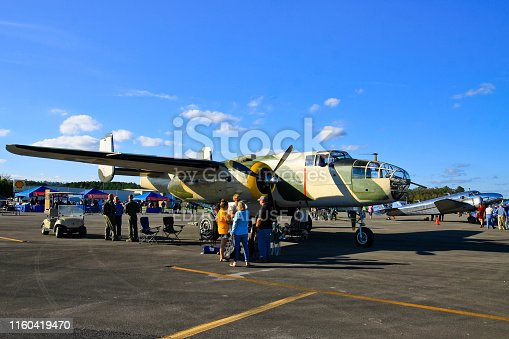Tuscalusa AL USA - October 13, 2018 : Taken this picture of a vintage plane parked on the tarmac in a public event with free entry. In the picture people are walking around on the tarmac and taking photo of the plane.