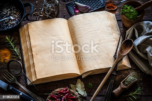 istock Vintage cookbook with kitchen utensils 919632024