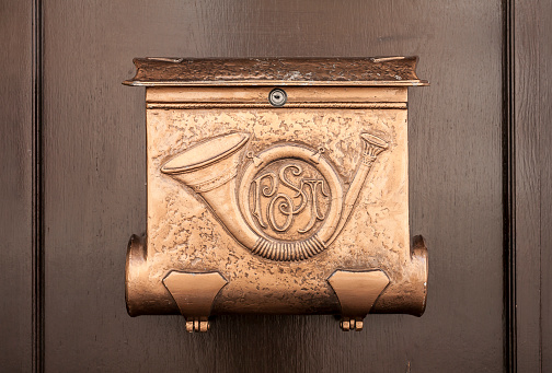 Vintage copper mailbox front view.