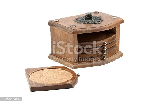 Vintage cork coasters in a wooden box isolated on white background. Copy space for text.