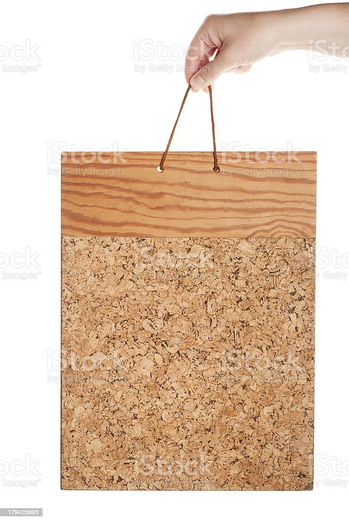 Vintage corkboard in hand royalty-free stock photo