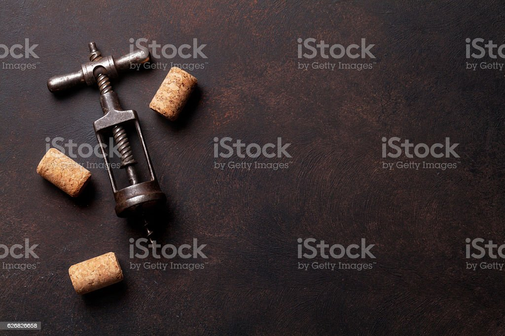 Vintage corkscrew and wine corks - Photo