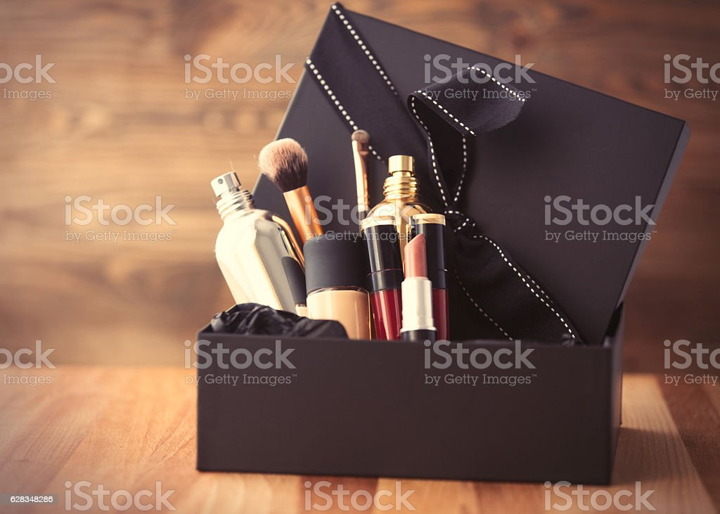 Vintage cosmetic bottles Vintage cosmetic bottles in gift box on wooden background Beauty Stock Photo
