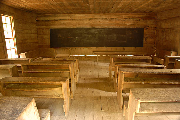 Vintage country one room school house. stock photo