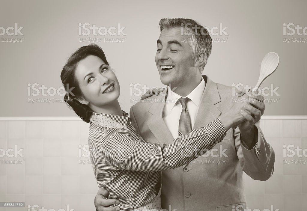 Vintage couple dancing in the kitchen stock photo