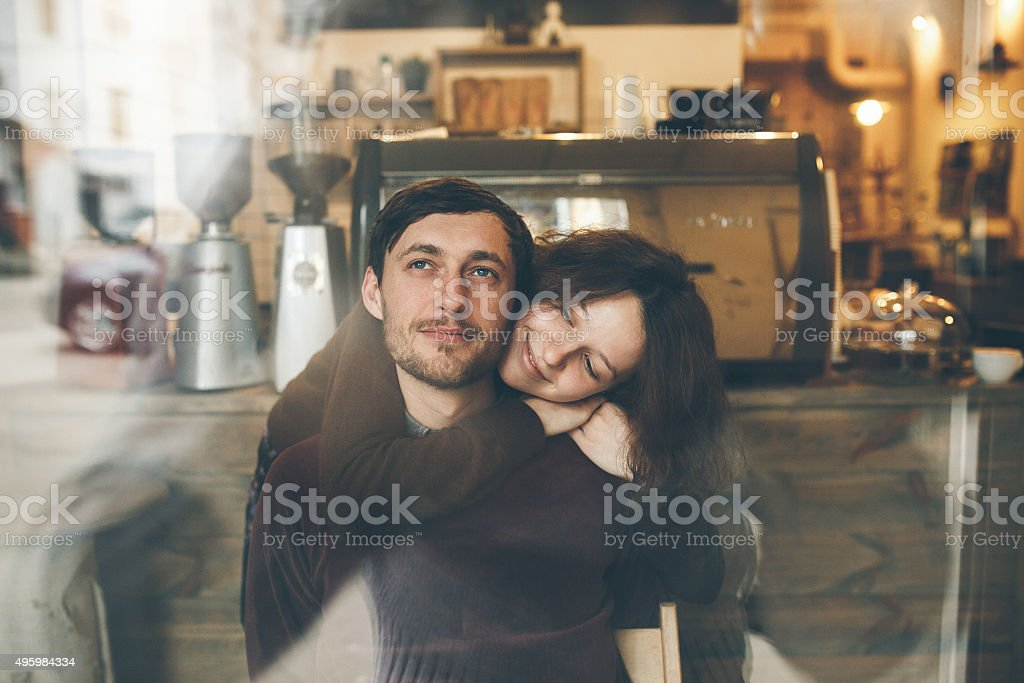 Vintage couple hugs and laughing .Coffee shop stock photo
