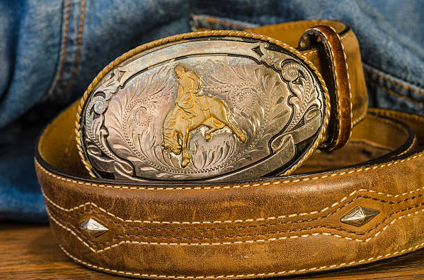 vintage cowboy belt buckle - belt stock photos and pictures