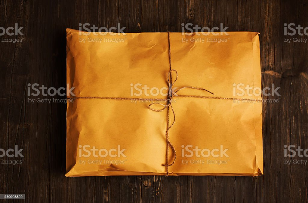 Vintage craft paper envelope tied up with string stock photo