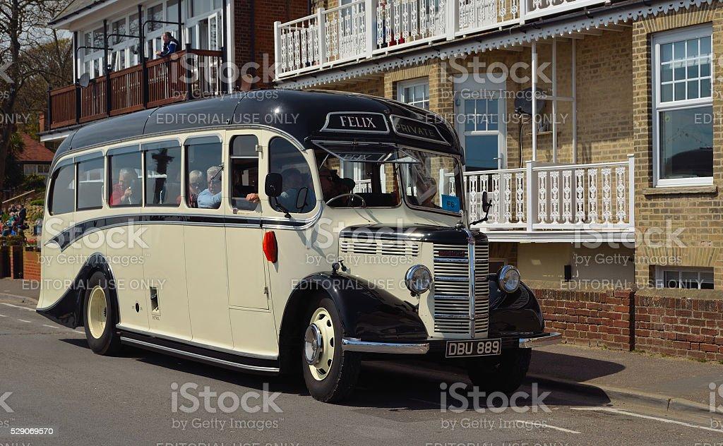 Vintage cream and black Bedford bus stock photo