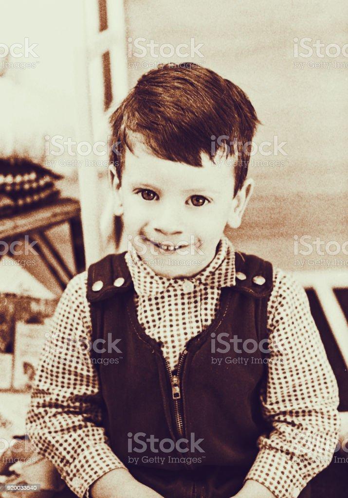 Vintage cute toddler looking at camera stock photo