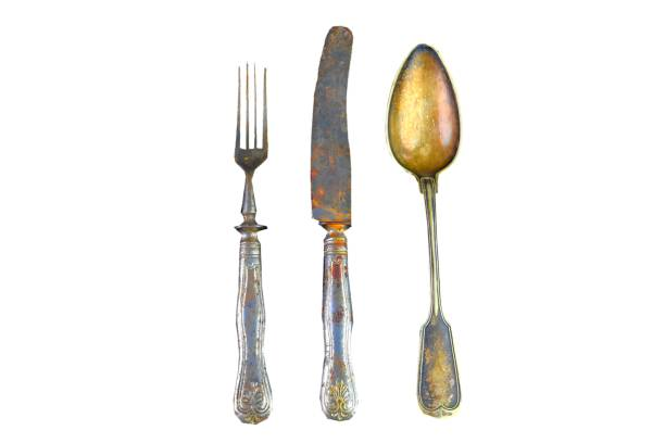 Vintage cutlery on a white background. Top view. Crazy concept for culinary and modern life. Contrast between shabby cutlery and excellent modern color stock photo
