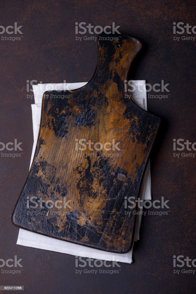 Vintage cutting board over towel on stone kitchen table stock photo