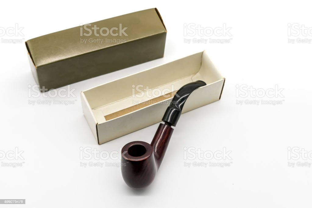 vintage dark brown pipe in its packaging isolated on white background stock photo
