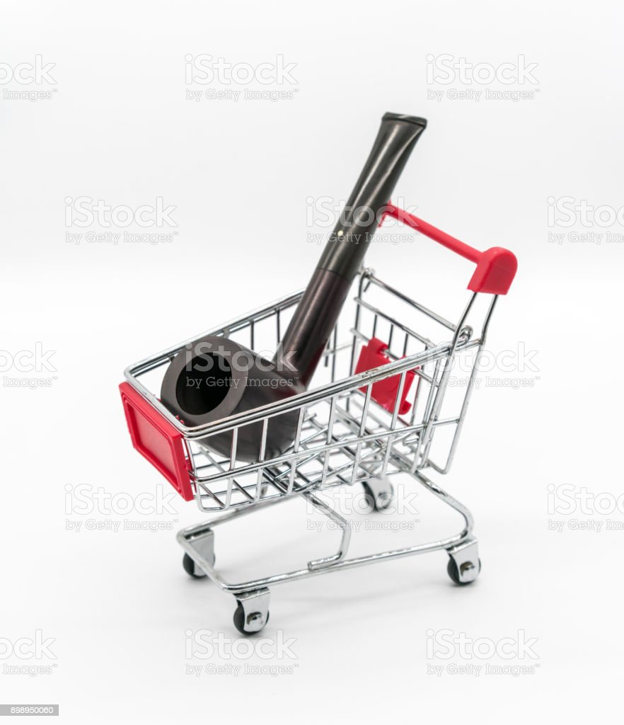 vintage dark brown pipe in red shopping cart isolated on white background stock photo