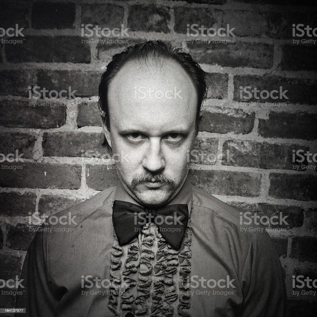 Vintage Dark Butler Man Frilly Shirt & Bow Tie royalty-free stock photo