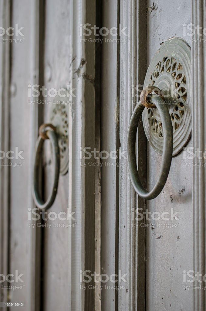 Vintage designed hotel entrance. Old wooden gate door handle stock photo