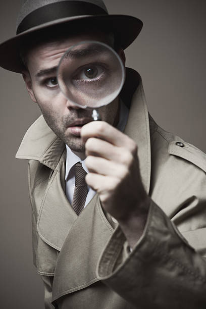 Vintage detective looking through a magnifier Funny vintage detective looking through a magnifier low scale magnification stock pictures, royalty-free photos & images