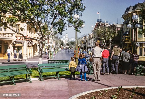 Vintage Disneyland park during the 1950's with the castle. Disneyland Park, originally Disneyland, is the first of two theme parks built at the Disneyland Resort in Anaheim, California, opened on July 17, 1955. It is the only theme park designed and built to completion under the direct supervision of Walt Disney. It was originally the only attraction on the property; its official name was changed to Disneyland Park to distinguish it from the expanding complex in the 1990s. It was the first Disney theme park. Copyright has expired on this artwork. Digitally restored historic photos.