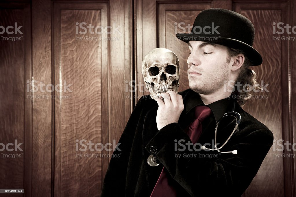 Vintage Doctor in Bowler Hat with Skull royalty-free stock photo