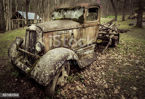 Gatlinburg, Tennessee, USA - March 25, 2016: Profile of an abandoned 1930's Dodge pick up truck on display at historic Ely's Mill on the outskirts of Gatlinburg.
