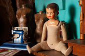 Vintage rag doll with celluloid or plastic head.