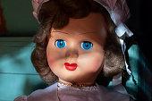 Vintage & antique toys. Retro porcelain doll close up.